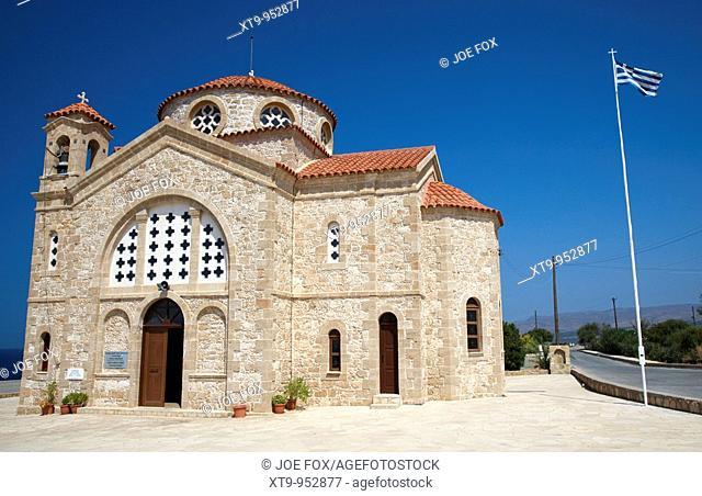 20th century agios georgios church with greek flag flying in st georges bay near pegeias republic of cyprus europe