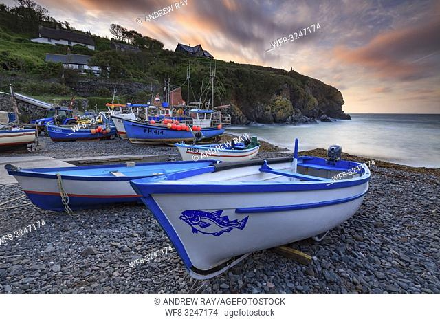 Boats on the shingle beach at Cadgwith on Cornwall's Lizard Peninsula. The image was captured at sunrise in mid April, using a long shutter speed to blur the...
