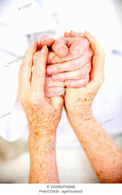 Holding hands of elderly person