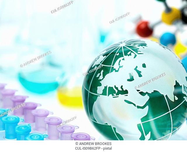 Globe with test tube holder, flasks and molecular model