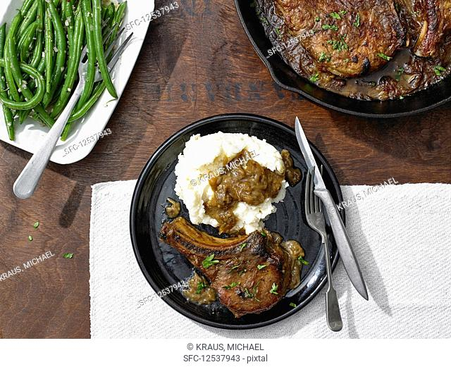 Smothered Bone-In Pork Chops with String Beans