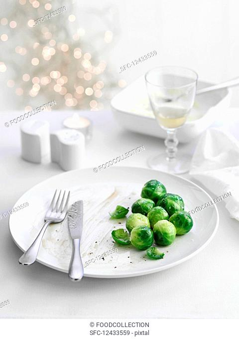 Brussels sprouts on plate with leftovers