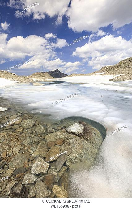 Ice and snow during summer thaw of the alpine lake Joriseen Jörifless Pass canton of Graubünden Engadin Switzerland Europe