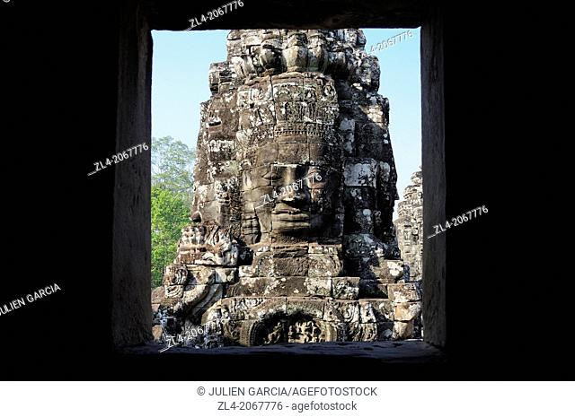 Enigmatic Lokesvara stone faces on the towers of the Bayon temple, Angkor Thom. Cambodia, Siem Reap, Angkor