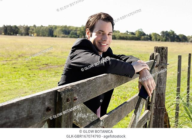 Businessman on a fence