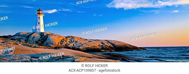 Panoramic photo of Peggys Cove Lighthouse and rock formations during sunset in Nova Scotia, Canada