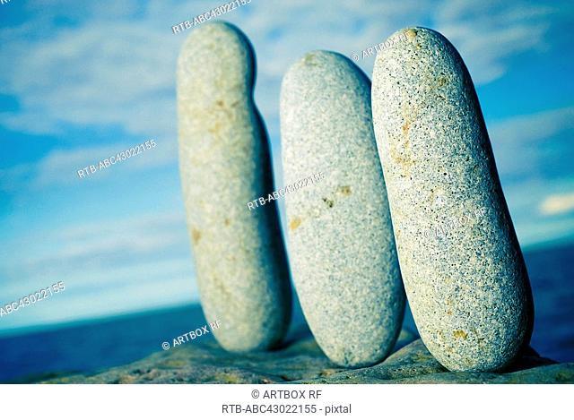 Three pebbles on a rock