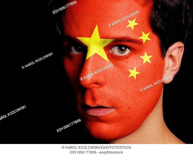 Flag of China Painted on a Face of a Young Man