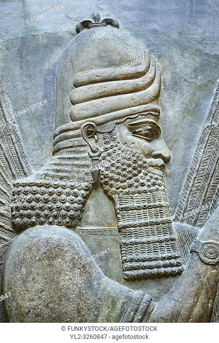 Stone relief sculptured panel of a Genie Blessing. Facade N. Inv AO 19865 from Dur Sharrukin the palace of Assyrian king Sargon II at Khorsabad, 713-706 BC