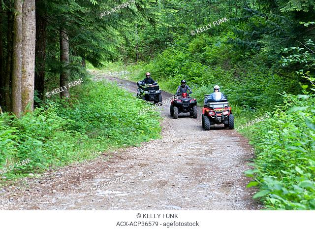 A group of ATV quad bikers take to the trails near Powell river on the upper Sunshine coast of the Vancouver coast and mountain range, British Columbia, Canada