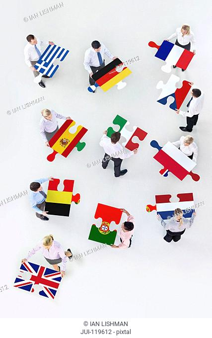 Overhead View Of Business People Holding European Flag Jigsaw To Illustrate Brexit