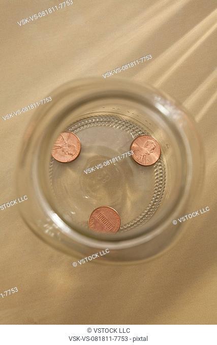 Studio shot of jar with coins