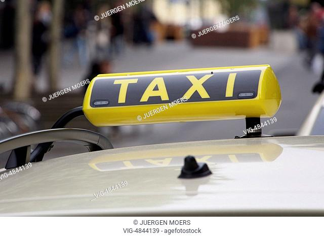 06.05.2014, Germany, Essen, Yellow taxi sign on taxi roof . - Essen, Germany, 06/05/2014
