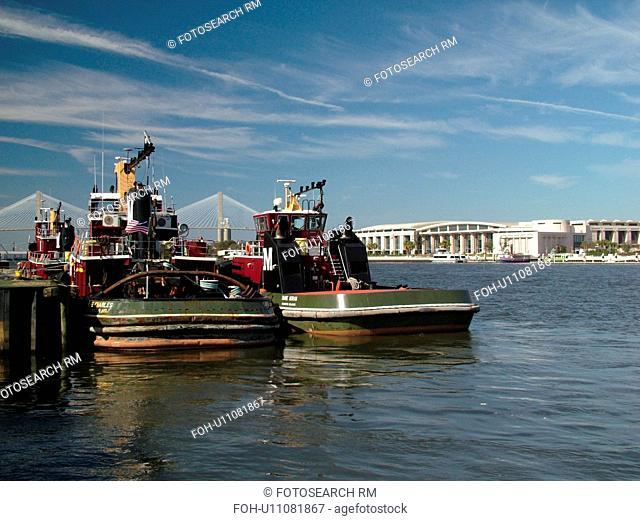 Savannah, GA, Georgia, two tugboats, riverfront