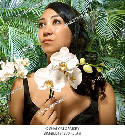 Japanese woman holding orchid