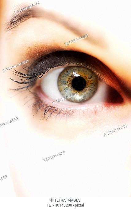 Woman's open eye, close up