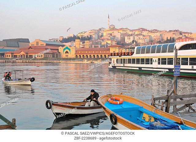 A boatman rowing across the Golden Horn near Eyüp. A few remaining boatmen are still ferrying people across the far end of the Golden Horn by Eyüp