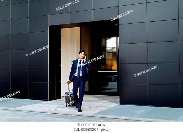 Businessman leaving on business trip