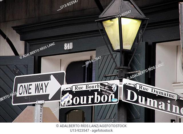Lamp, lantern and sign at Bourbon and Dumaine Street corner, French Quarter, New Orleans, Louisiana, USA