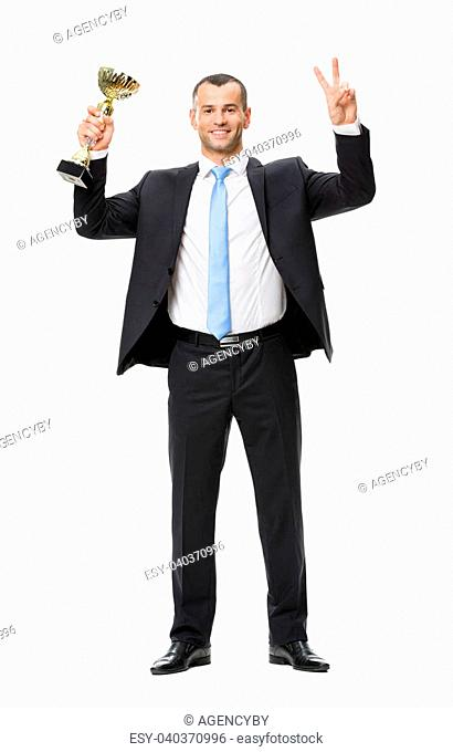 Full-length portrait of victory gesturing businessman with gold cup, isolated on white. Concept of leadership and success