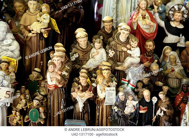 Religious figures for sale to tourists in Padua, Veneto, Italy