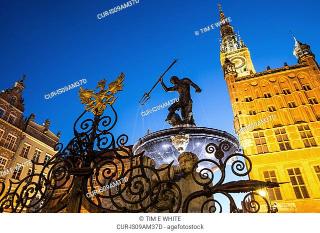 Silhouette of Neptunes fountain at night, Gdansk, Poland