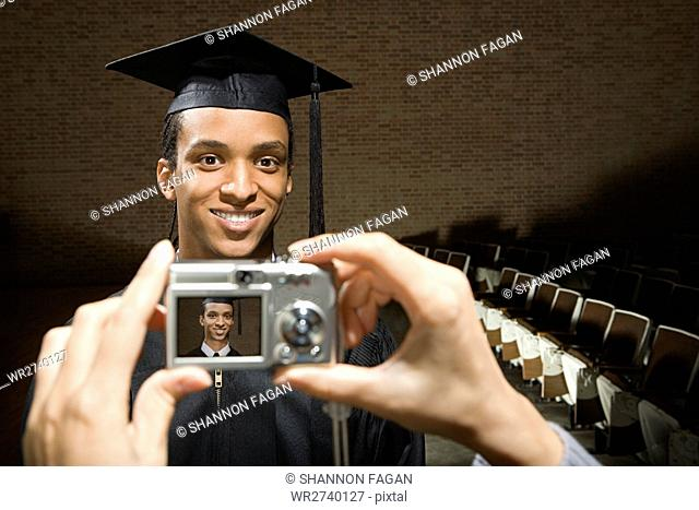 Male graduate being photographed