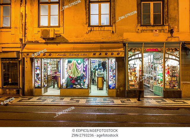 dry goods stores at night, baixa district, lisbon, portugal
