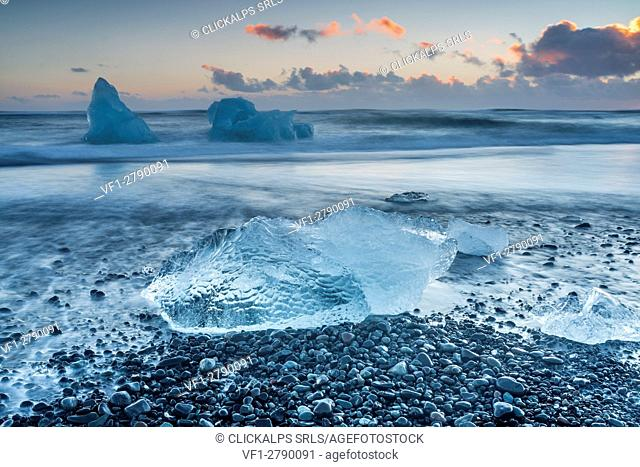 Block of ice on the black beach in Jokulsarlon Glacier Lagoon, Eastern Iceland, Europe