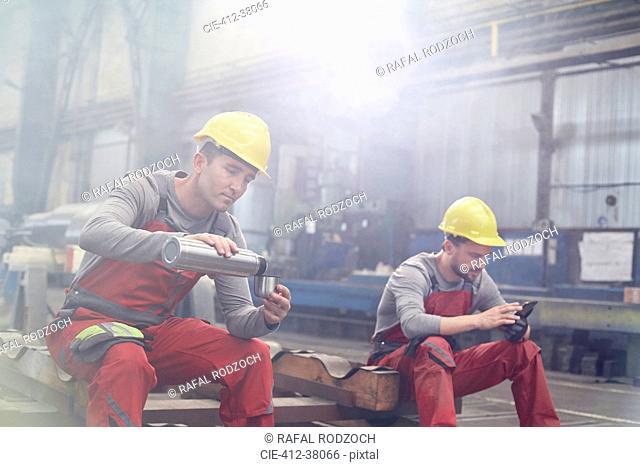 Factory workers taking coffee break