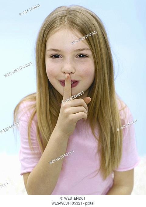 Girl 6-7, finger om mouth, portrait