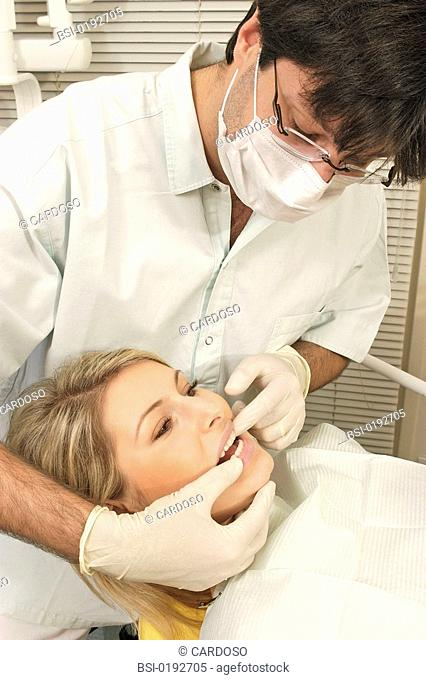 WOMAN RECEIVING DENTAL CARE<BR>Photo essay from dental office