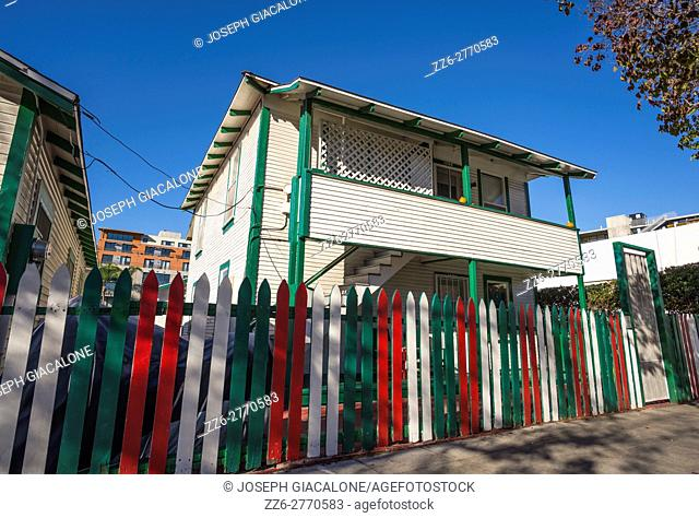 Houses with wooden fences painted in the colors of the Italian Flag. Little Italy, San Diego, California