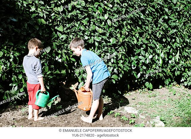 Children watering the garden