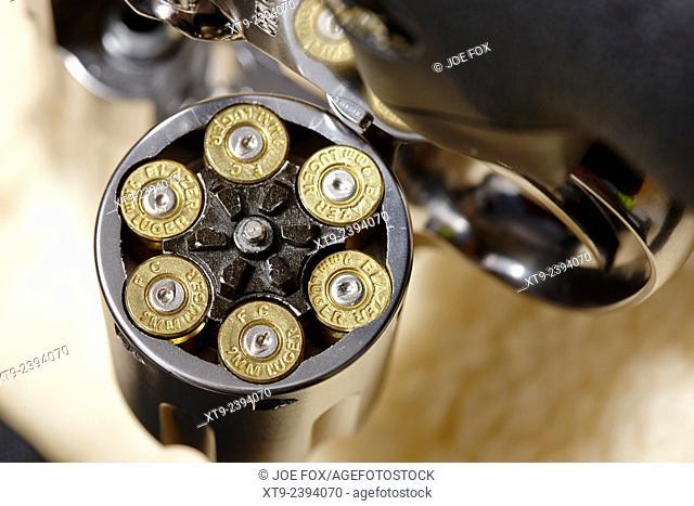 revolver handgun with fired 9mm cartridges in cylinder