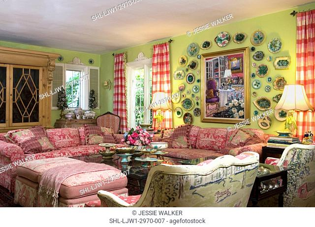 LIVING ROOMS: Bright green walls with bright raspberry accent colors, collection displays of plates, toile fabric sofas, bergere chair backs to camera