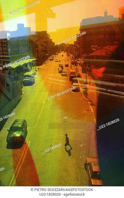 New York City, view of a street in Jackson Heights, Queens, through a colored glass of a subway station