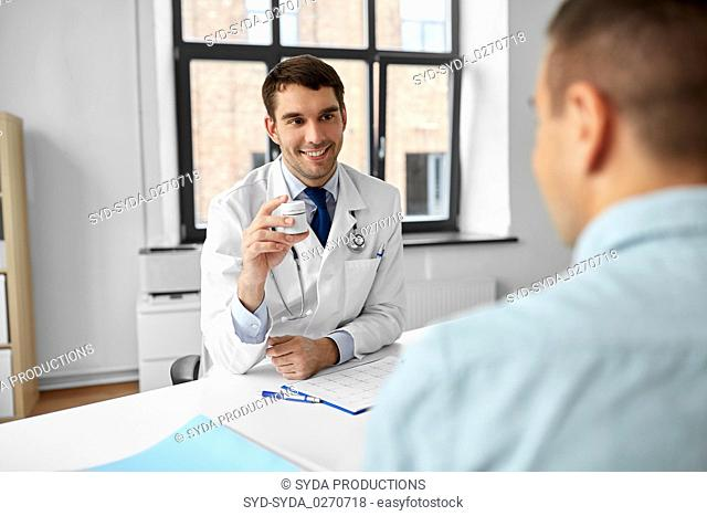 doctor showing medicine to patient at hospital
