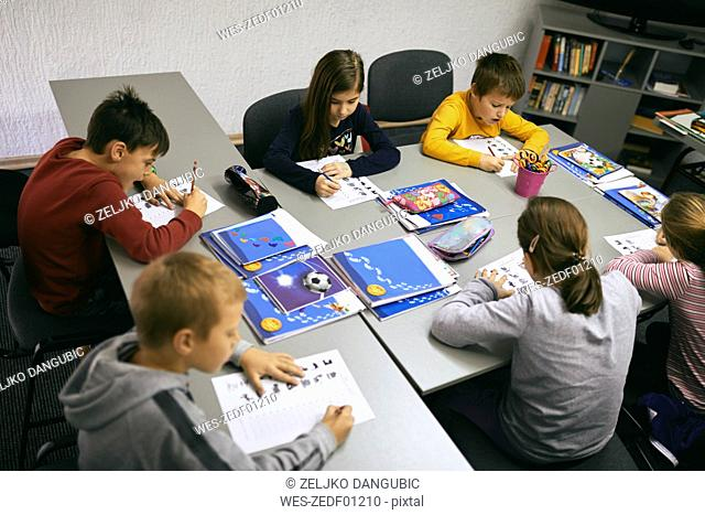 Students learning in class