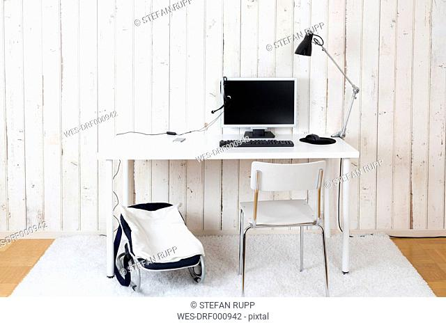 Home office with personal computer and bouncy seat