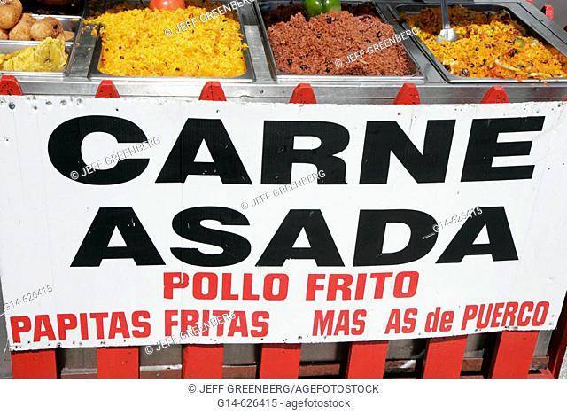 Annual Hispanic festival, food vendor sign, meat, chicken, rice, Spanish. Calle Ocho. Little Havana. Miami. Florida. USA