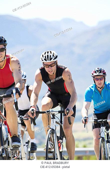 Cyclists in race on rural road