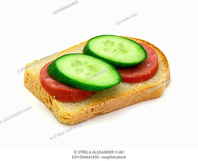 sandwich with sausage and a cucumber
