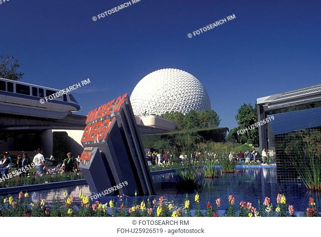 Disney World, FL, Orlando, monorail, Epcot, Lake Buena Vista, Florida, Monorail passes by the fountain outside the Universe of Energy presented by Exxon and...