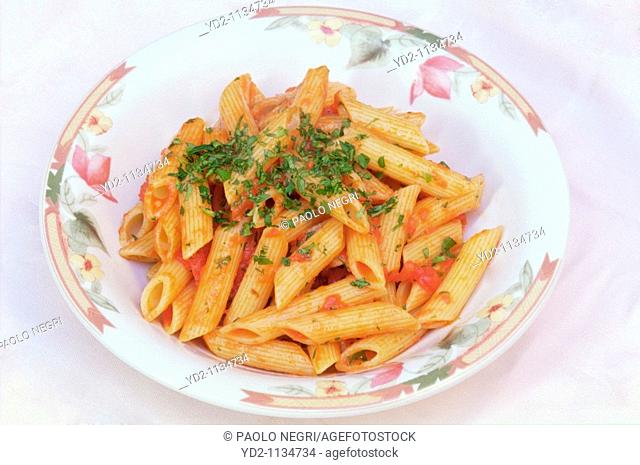 Penne al pomodoro pasta with tomatoes, Italy