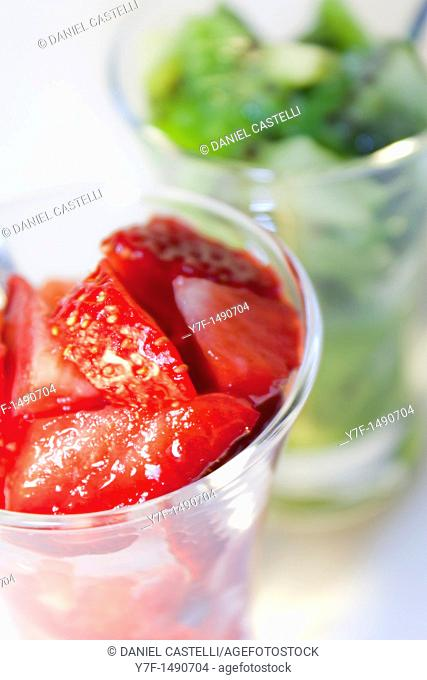Glasses of fruits, kiwi and strawberry
