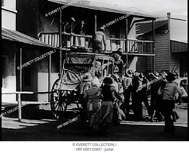 Wide shot people gathering around horse drawn carriage