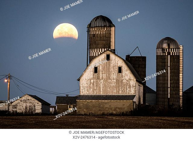 Lunar eclipse over farm buildings near Shakopee, Minnesota