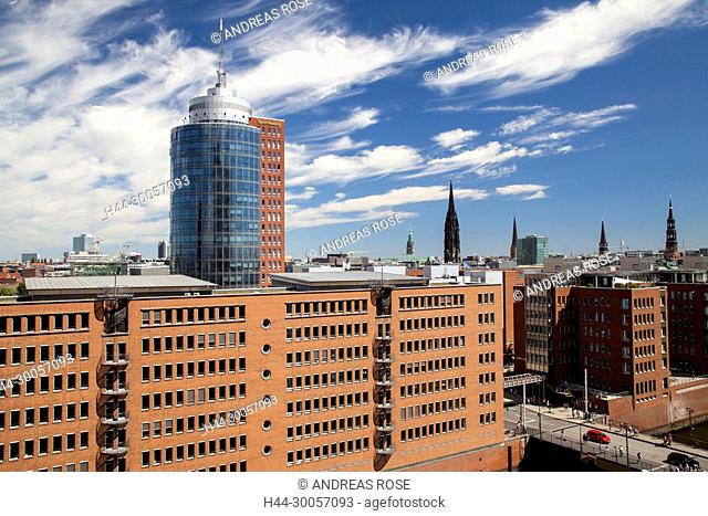 View of new office buildings in the Speicherstadt, in the background of the HTC, Hanse Trade Tower, Hamburg, Germany