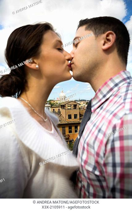 Couple kissing in Rome, Italy